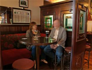 Couple chatting in Devitts Pub Dublin